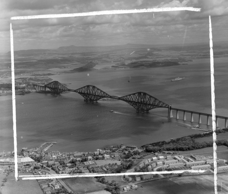 Forth Bridge from South/West Dalmeny, West Lothian, Scotland. Oblique aerial photograph taken facing North/East. This image was marked by AeroPictorial Ltd for photo editing.
