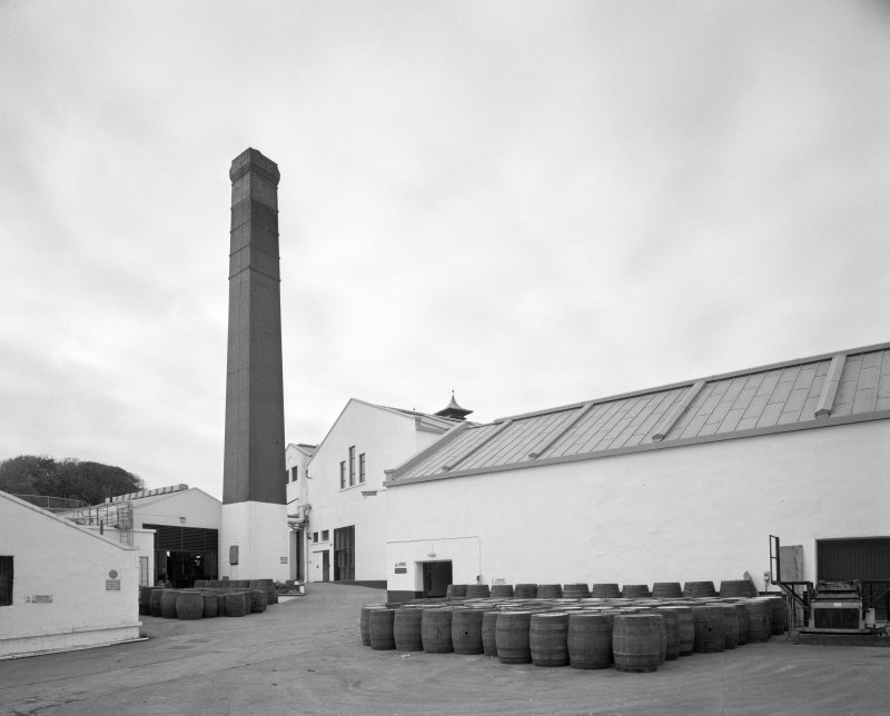 Lagavulin Distillery View from SE across yard of boilerhouse, chimney, and still house