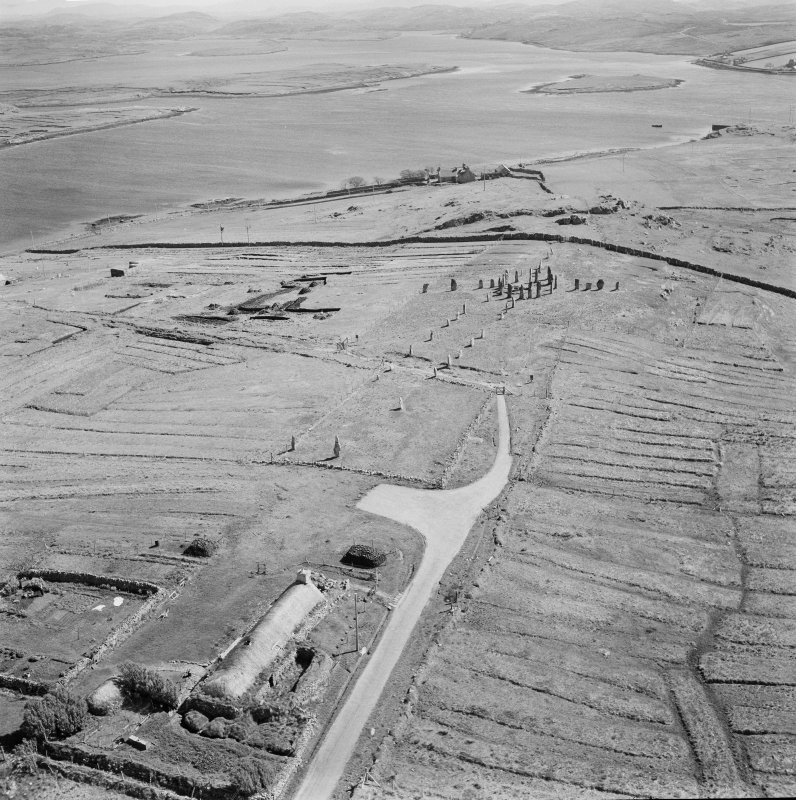 Oblique aerial view of Callanish stone circle and stone row, Lewis.