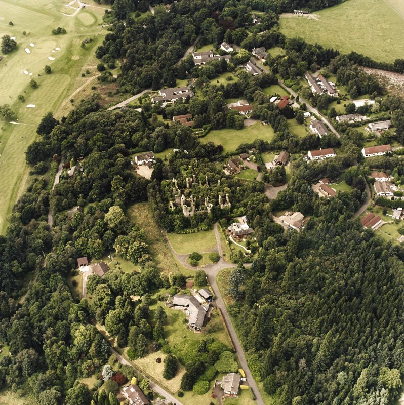Oblique aerial view centred on the remains of the country house, taken from the SE.