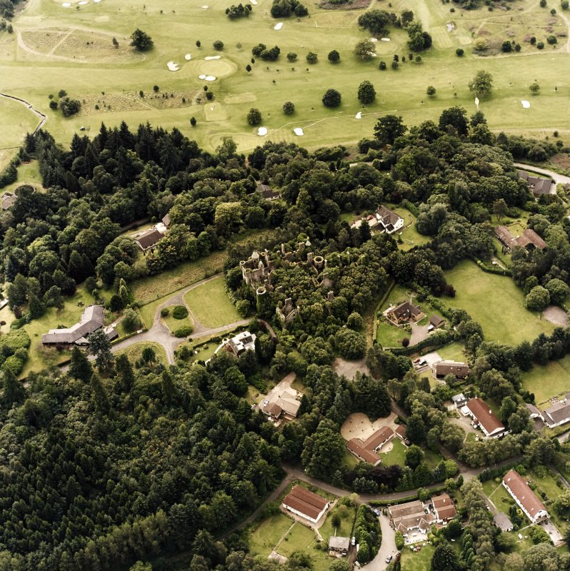 Oblique aerial view centred on the remains of the country house, taken from the NE.