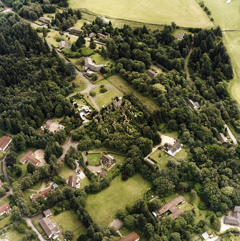 Oblique aerial view centred on the remains of the country house, taken from the NW.