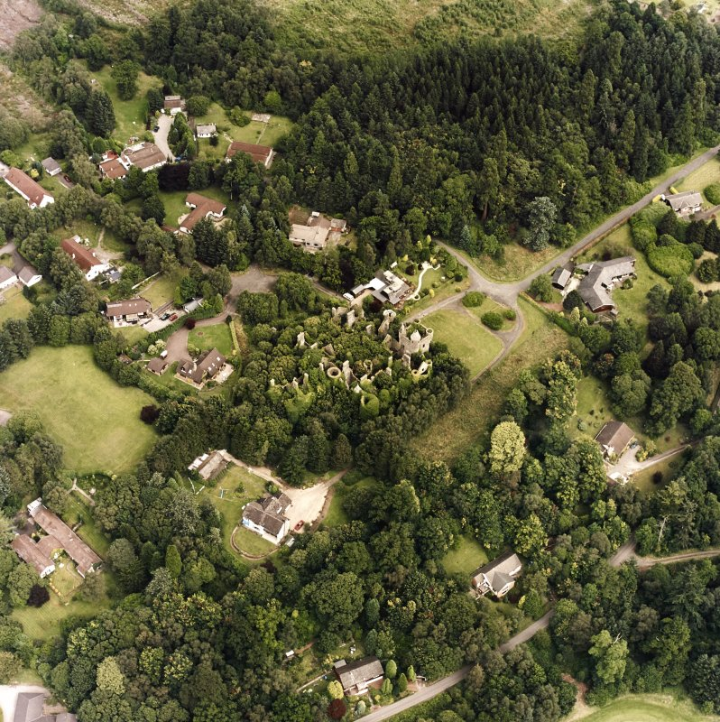 Oblique aerial view centred on the remains of the country house, taken from the WSW.
