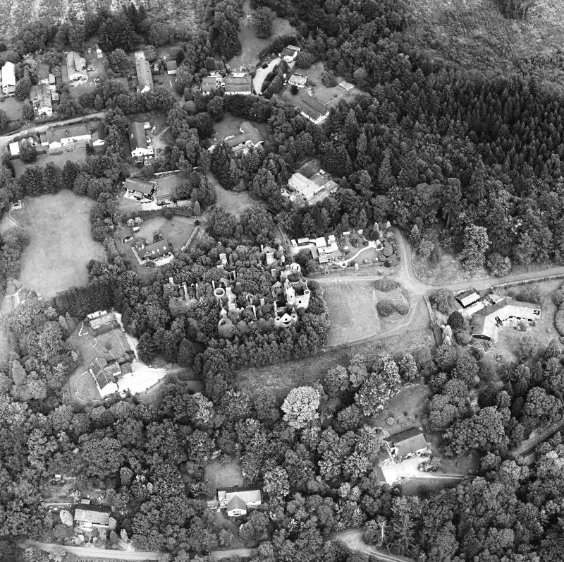 Oblique aerial view centred on the remains of the country house, taken from the SW.
