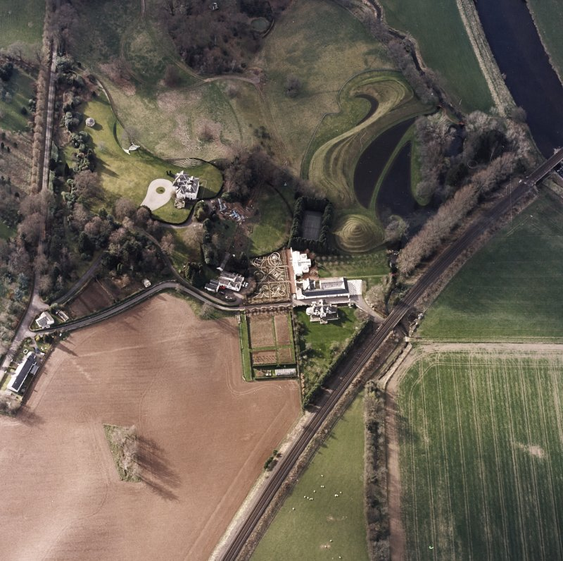 Oblique aerial view centred on the garden and country house, taken from the ESE.