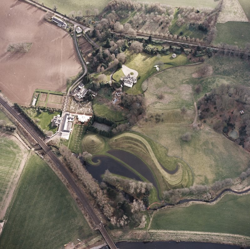 Oblique aerial view centred on the garden and country house, taken from the NNE.