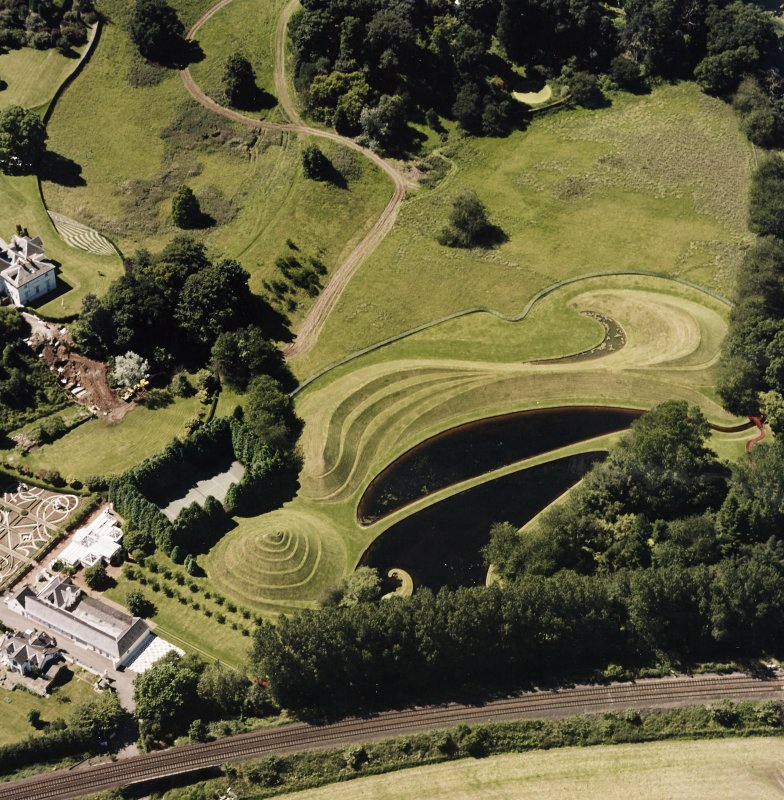 Oblique aerial view centred on the garden and country house, taken from the ENE.