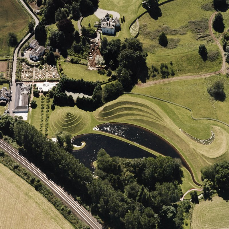 Oblique aerial view centred on Portrack house and garden, taken from the NE.
