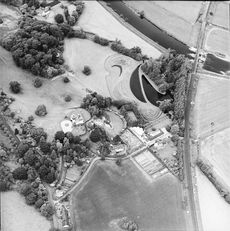 Oblique aerial view centred on the country house and garden, taken from the SE.