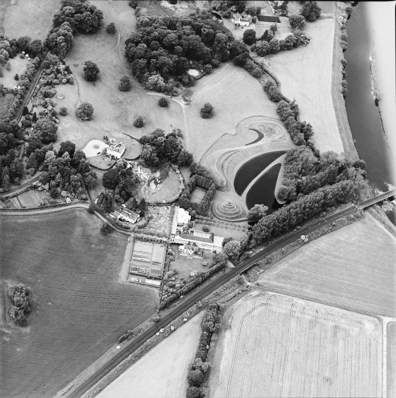 Oblique aerial view centred on the country house and garden, taken from the ESE.