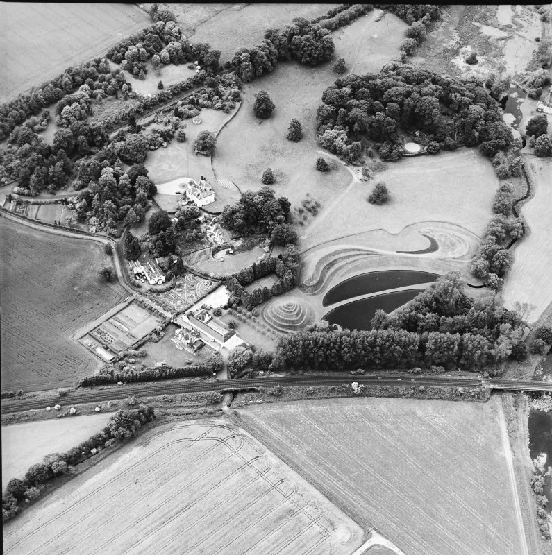 Oblique aerial view centred on the country house and garden, taken from the ENE.
