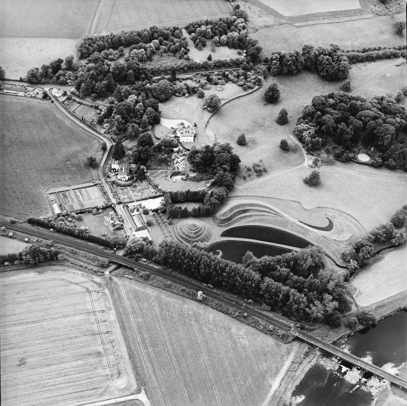 Oblique aerial view centred on the country house and garden, taken from the NE.