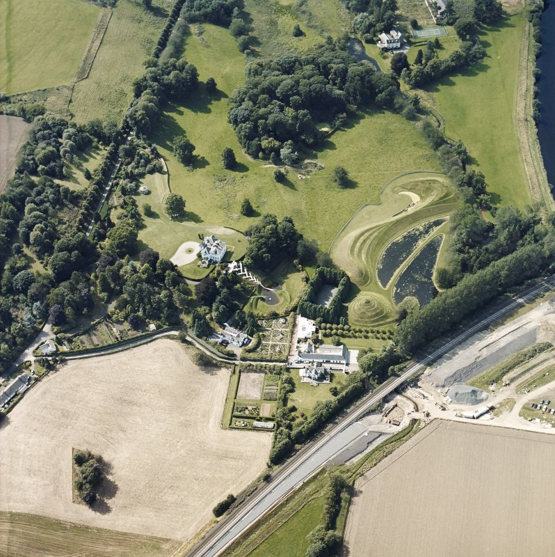 Oblique aerial view centred on the country house and garden with the lodge adjacent, taken from the ESE.