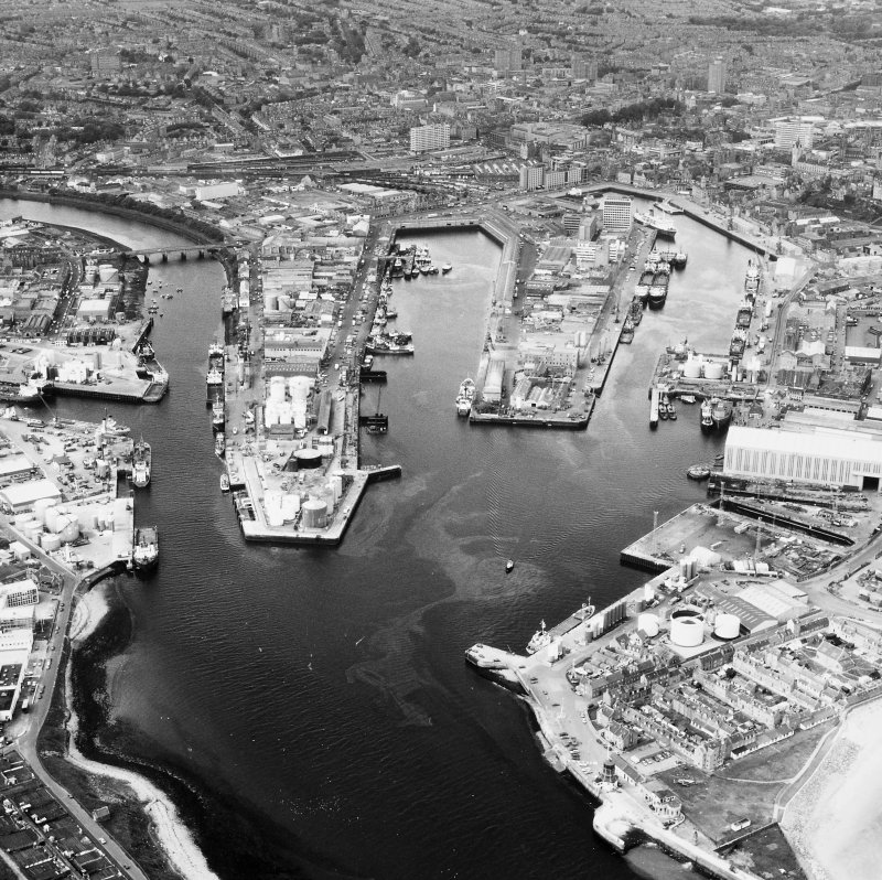 Aberdeen, Harbour and City Centre. General oblique aerial view.
