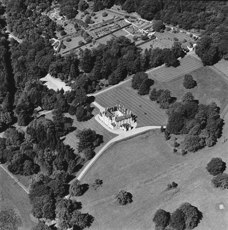 Oblique aerial view of Leith Hall centred on the country house, walled garden and offices, taken from the SE.