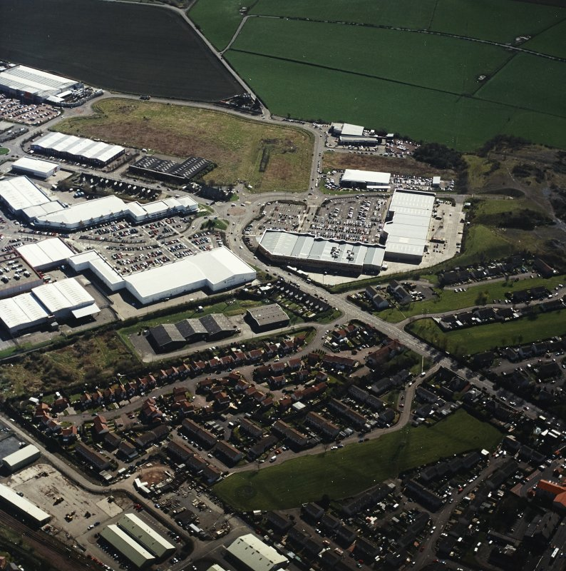 Oblique aerial view centred on the retail park, taken from the NW.
