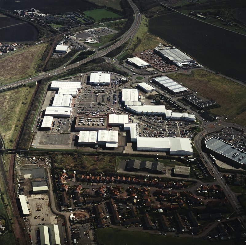 Oblique aerial view centred on the retail park, taken from the WNW.