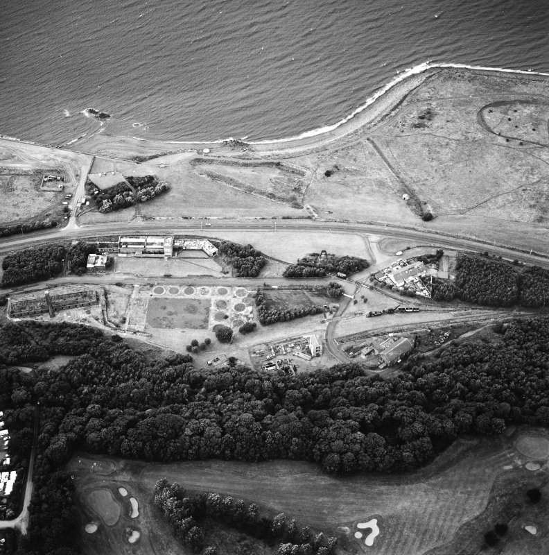 Oblique aerial view centred on the museum and remains of the coal mine, brick-works, tile-works and harbour, taken from the SSE.