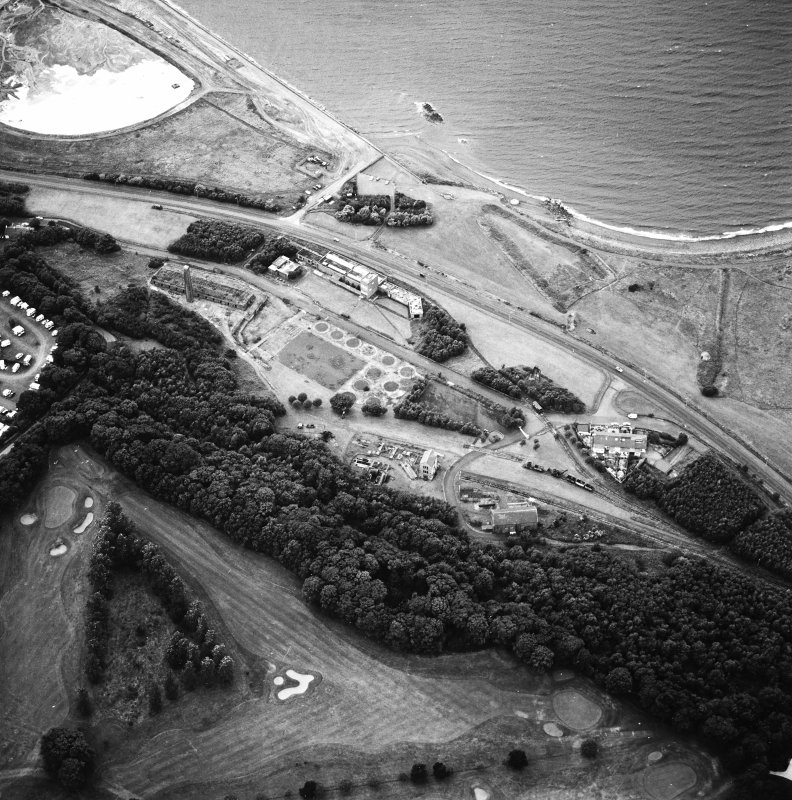 Oblique aerial view centred on the museum and remains of the coal mine, brick-works, tile-works and harbour, taken from the SE.