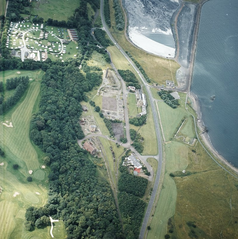Oblique aerial view centred on the museum and the remains of the coal mine, brick and tileworks and harbour, taken from the ENE.