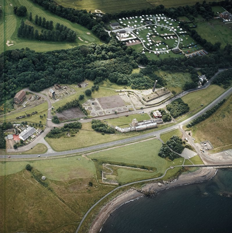 Oblique aerial view centred on the museum and the remains of the coal mine, brick and tileworks and harbour, taken from the N.