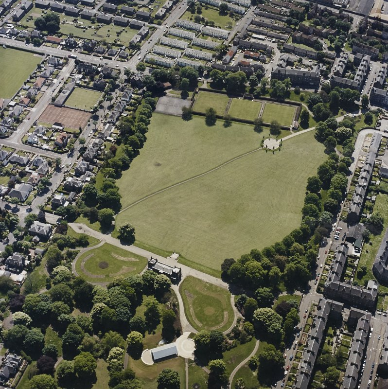 Oblique aerial view centred on the park and pavilion, taken from the NW.