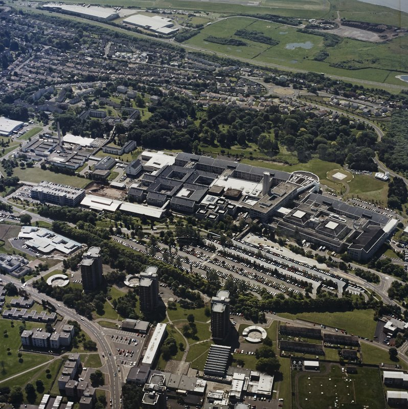 Oblique aerial view centred on the hospital, taken from the N.