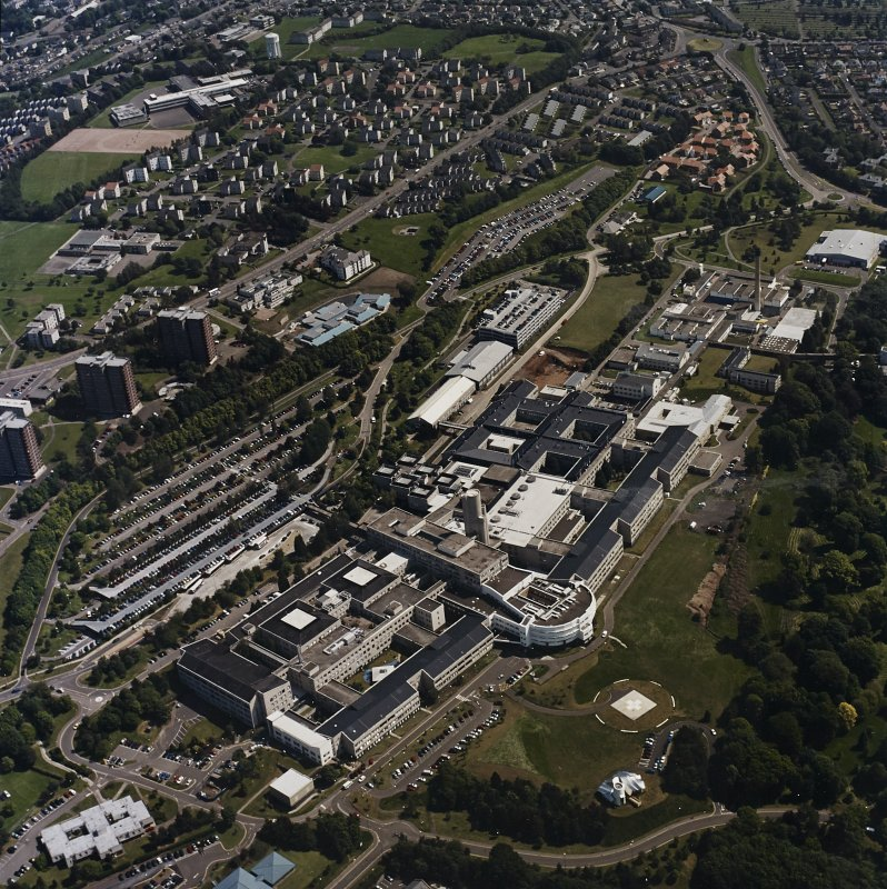 Oblique aerial view centred on the hospital, taken from the WSW.