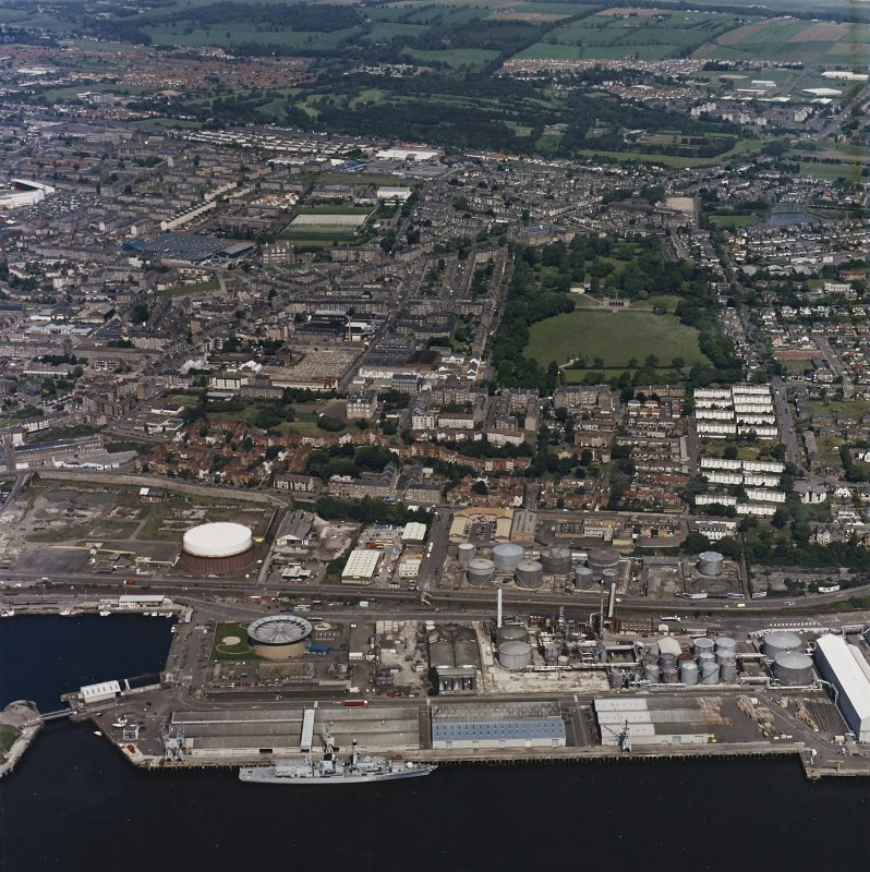 General oblique aerial view of Dundee centred on the park and pavilion with the oil refinery adjacent, taken from the SSE.