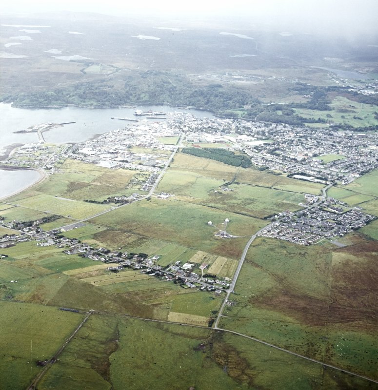 Oblique aerial view centred on the township with the town adjacent, taken from the ENE.