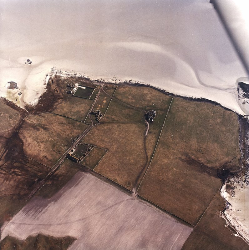 Oblique aerial view centred on the country house and the remains of the house, farmstead and walled garden, taken from the NW.