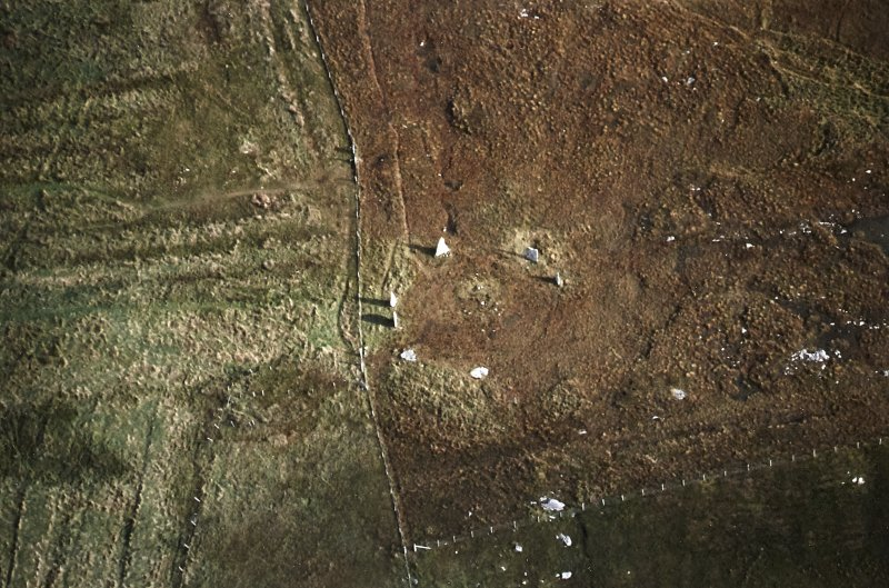 Oblique aerial view centred on the remains of the stone circle with lazy beds adjacent, taken from the W.