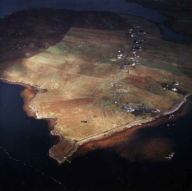 General oblique aerial view centred on the research centre, stone circle and stone alignments with the township adjacent, taken from the SSE.