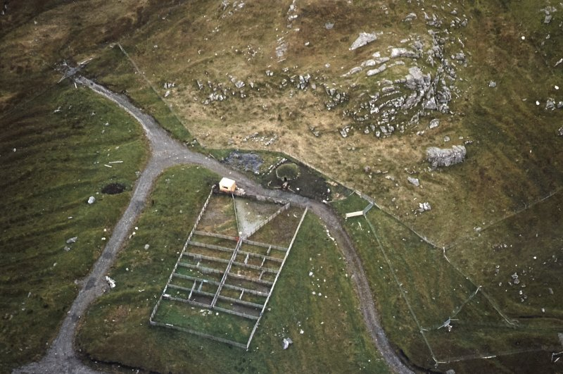 Oblique aerial view centred on the reconstructed shieling hut and sheep pen, taken from the N.