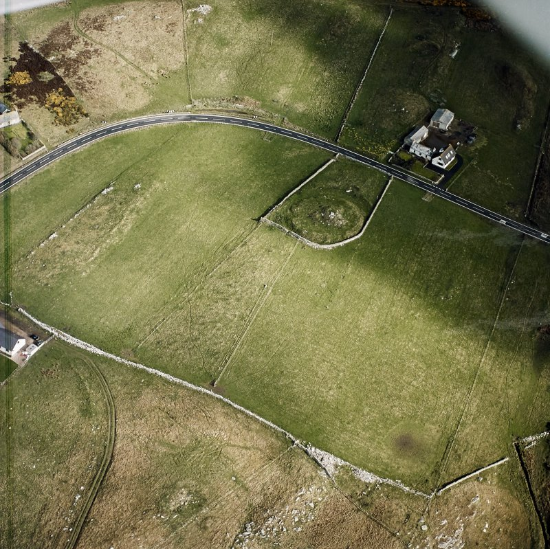 Oblique aerial view centred on the remains of the broch taken, from the S.