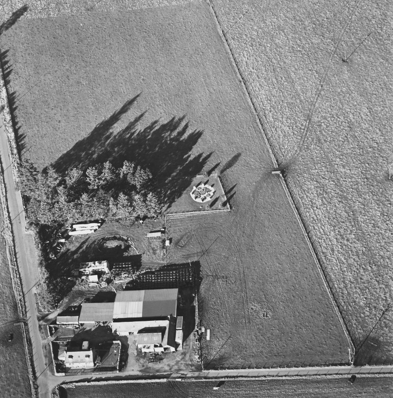 Oblique aerial view of Cullerlie centred on the remains of a stone circle, taken from the S.