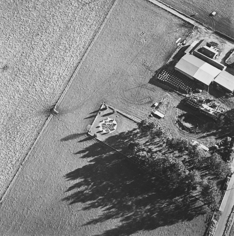 Oblique aerial view of Cullerlie centred on the remains of a stone circle, taken from the NW.