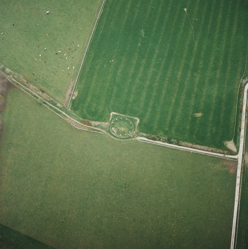 Oblique aerial view of the remains of the recumbent stone circle, taken from the SE.