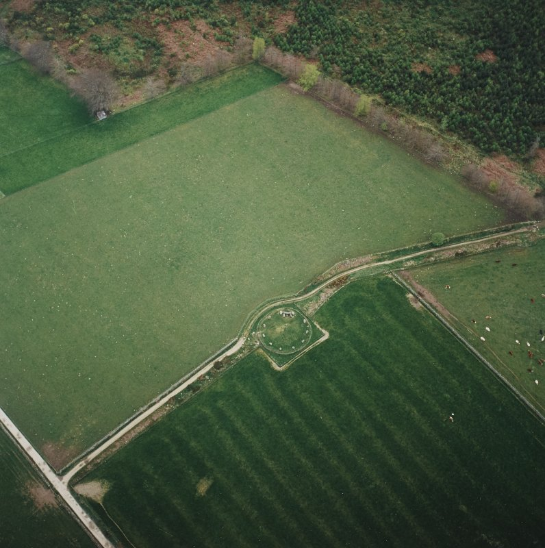 Oblique aerial view of the remains of the recumbent stone circle, taken from the N.