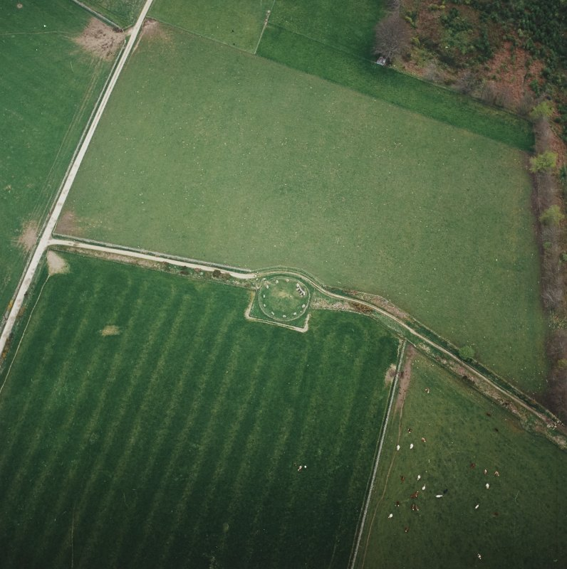 Oblique aerial view of the remains of the recumbent stone circle, taken from the NNW.