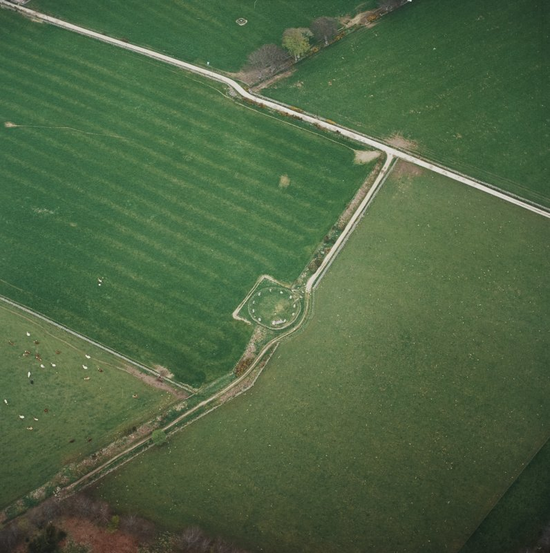 Oblique aerial view of the remains of the recumbent stone circle, taken from the SW.