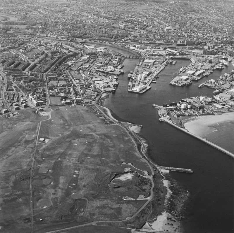 Oblique aerial view centred on the coastal battery with the harbour in the background, taken from the E.