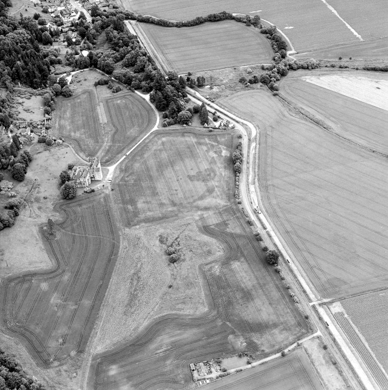 Oblique aerial view centred on the cropmarks of pits and linear cropmarks, with tower house, pits and walled garden adjacent, taken from the WSW.