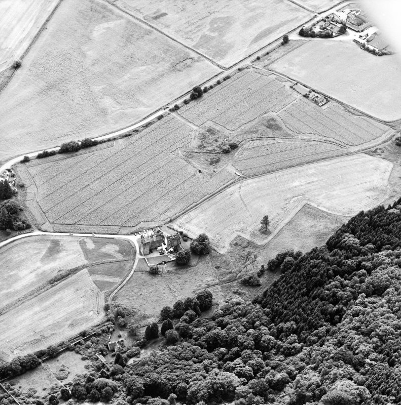 General oblique aerial view centred on the tower-house and country house, taken from the NE.