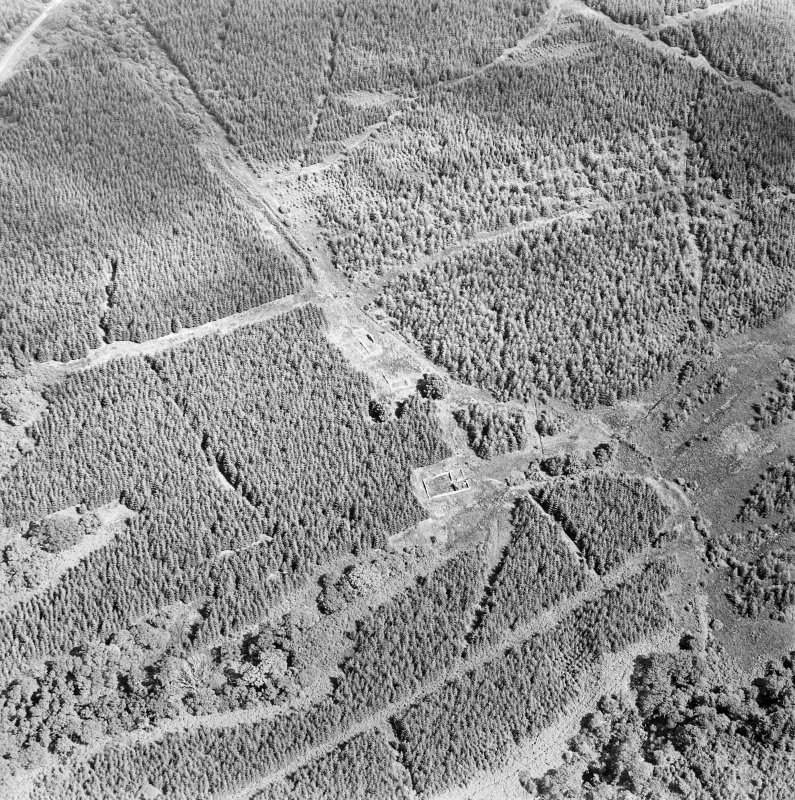 Oblique aerial view centred on the remains of the country house, taken from the W.