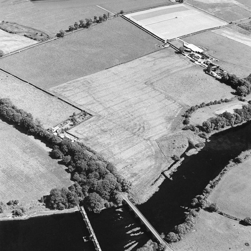 Oblique aerial view of Glenlochar, taken from NW, centered on roman fort.