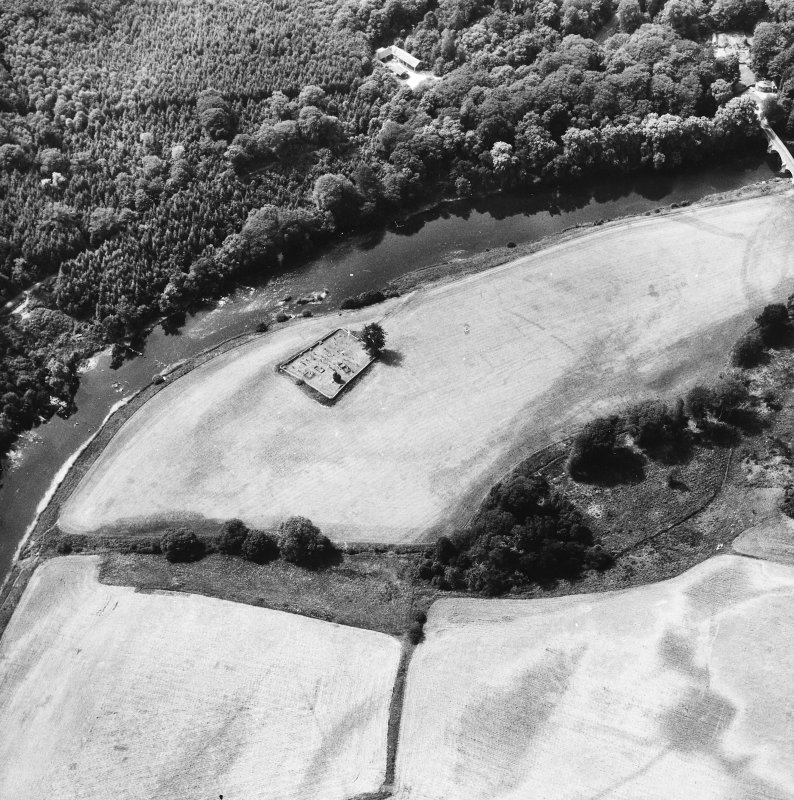 Oblique aerial view centred on burial ground from NE.