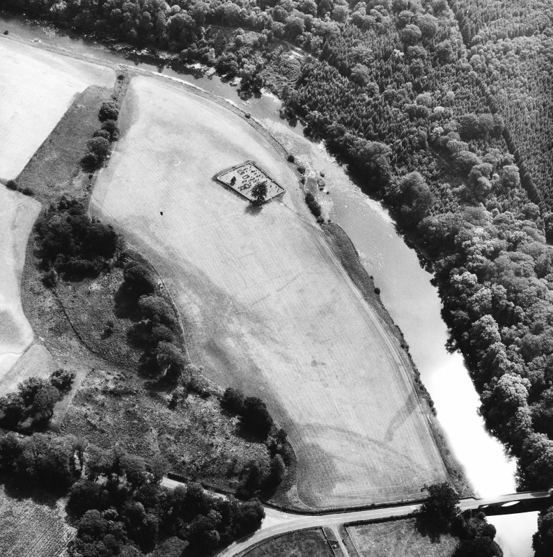 Oblique aerial view centred on burial ground from NW.