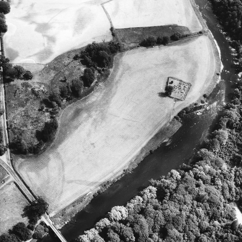 Oblique aerial view centred on burial ground from W.