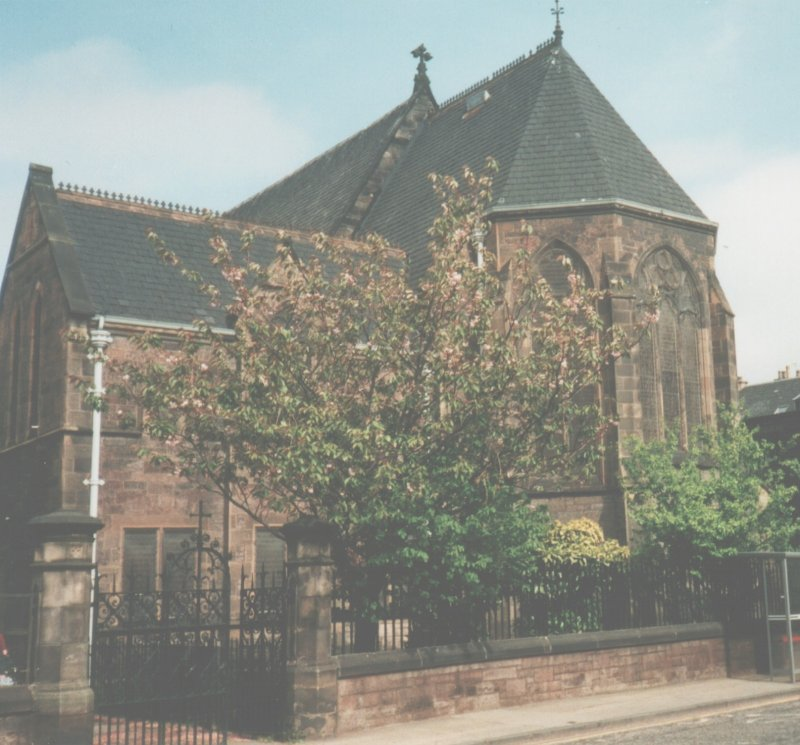 View of east end of St Mary's Star of the Sea, from Constitution Street. Chancel added 1910-11, followed by sacristy (which can be seen in image) and new north aisle, with 6 confessionals. Originally the altar was at the west end of the building but the whole interior was reoriented in 1910 and the altar was placed in the new chancel.